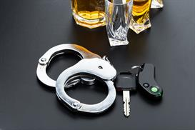 Handcuffs, car keys and alcohol - DUI Defense in Washington